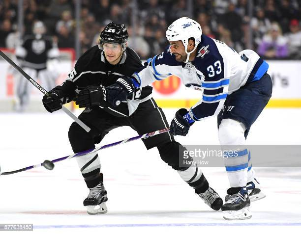 Dustin Byfuglien of the Winnipeg Jets breaks up a pass from Nic Dowd of the Los Angeles Kings during the second period at Staples Center on November...