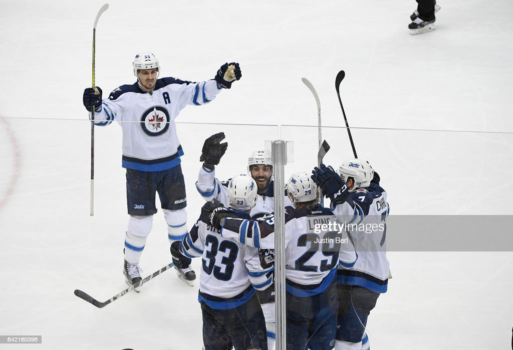 Dustin Byfuglien #33 of the Winnipeg Jets celebrates his goal with teammates in the third period during the game against the Pittsburgh Penguins. at PPG PAINTS Arena on February 16, 2017 in Pittsburgh, Pennsylvania.