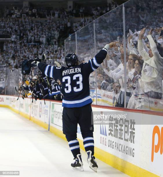 Dustin Byfuglien of the Winnipeg Jets celebrates his second goal against the Nashville Predators in Game Three of the Western Conference Second Round...