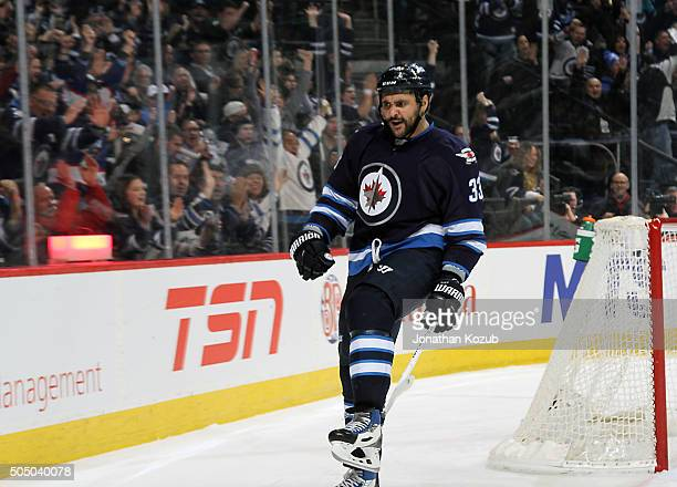 Dustin Byfuglien of the Winnipeg Jets celebrates his second period goal against the Nashville Predators at the MTS Centre on January 14 2016 in...