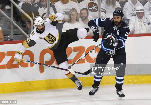 Dustin Byfuglien of the Winnipeg Jets checks PierreEdouard Bellemare of the Vegas Golden Knights during the third period in Game Five of the Western...