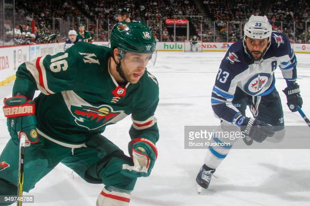 Dustin Byfuglien of the Winnipeg Jets defends Jason Zucker of the Minnesota Wild in Game Three of the Western Conference First Round during the 2018...