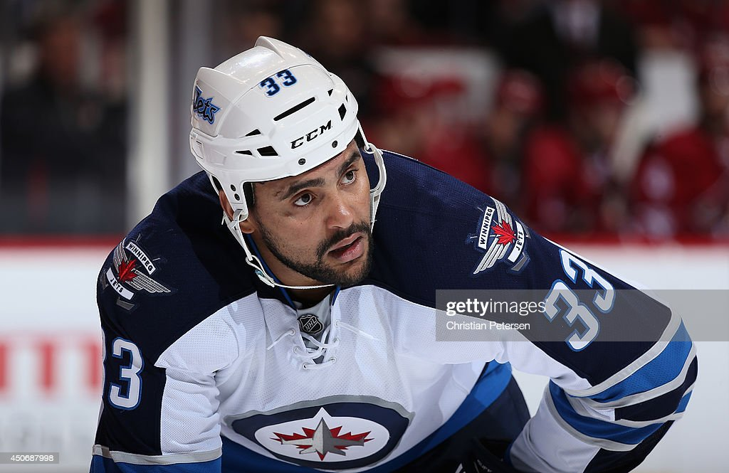 Dustin Byfuglien #33 of the Winnipeg Jets during the NHL game against the Phoenix Coyotes at Jobing.com Arena on April 1, 2014 in Glendale, Arizona.