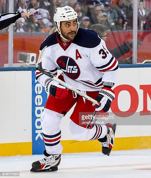 Dustin Byfuglien of the Winnipeg Jets follows the play down the ice during second period action against the Edmonton Oilers in the 2016 Tim Hortons...