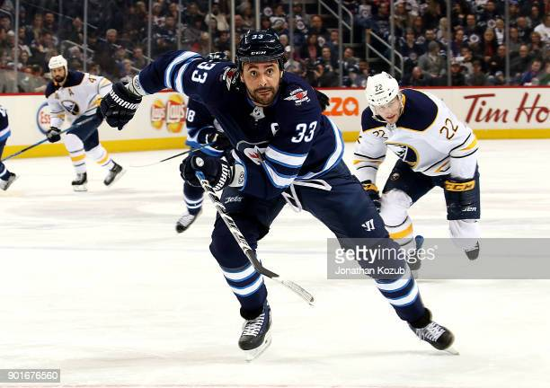 Dustin Byfuglien of the Winnipeg Jets follows the play down the ice during first period action against the Buffalo Sabres at the Bell MTS Place on...