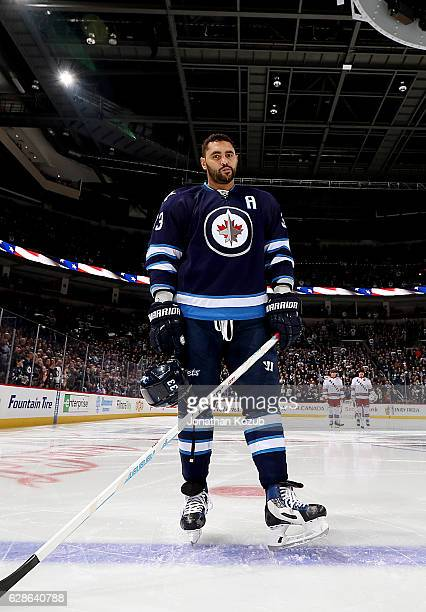 Dustin Byfuglien of the Winnipeg Jets gets his game face on prior to puck drop against the New York Rangers at the MTS Centre on December 8 2016 in...