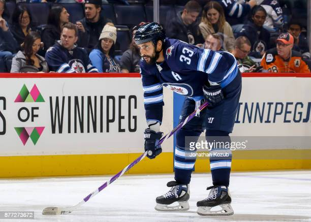 Dustin Byfuglien of the Winnipeg Jets gets set for a second period faceoff against the Philadelphia Flyers at the Bell MTS Place on November 16 2017...