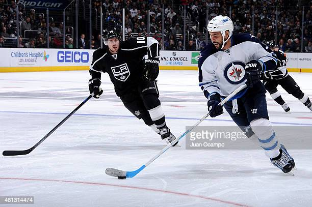 Dustin Byfuglien of the Winnipeg Jets handles the puck during a game against the Los Angeles Kings at STAPLES Center on January 10 2015 in Los...