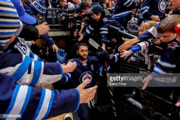 Dustin Byfuglien of the Winnipeg Jets heads to the ice for the start of the pregame warm up prior to NHL action against the Philadelphia Flyers at...