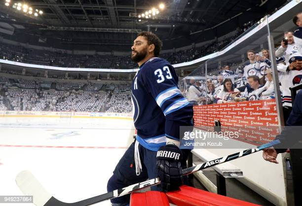 Dustin Byfuglien of the Winnipeg Jets hits the ice for the pregame warm up prior to NHL action against the Minnesota Wild in Game Five of the Western...
