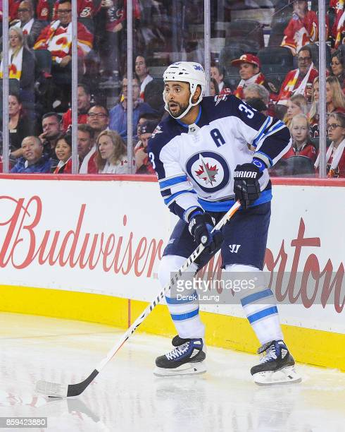 Dustin Byfuglien of the Winnipeg Jets in action against the Calgary Flames during an NHL game at Scotiabank Saddledome on October 7 2017 in Calgary...