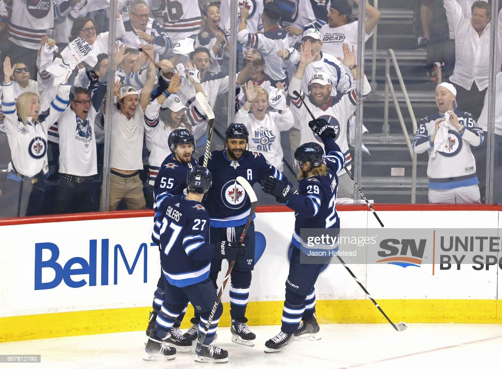 Dustin Byfuglien #33 of the Winnipeg Jets is congratulated by his teammates after scoring a first period goal against the Vegas Golden Knights in Game One of the Western Conference Finals during the 2018 NHL Stanley Cup Playoffs at Bell MTS Place on May 12, 2018 in Winnipeg, Canada.