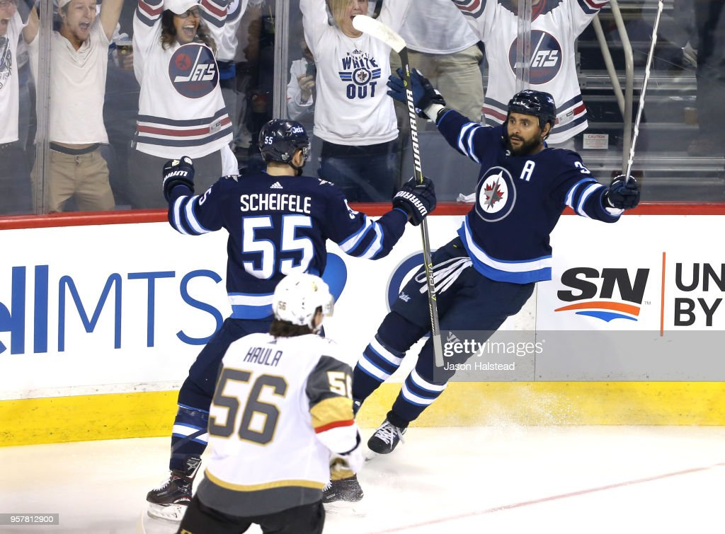 Dustin Byfuglien #33 of the Winnipeg Jets is congratulated by his teammate Mark Scheifele #55 after scoring a first period goal against the Vegas Golden Knights in Game One of the Western Conference Finals during the 2018 NHL Stanley Cup Playoffs at Bell MTS Place on May 12, 2018 in Winnipeg, Canada.