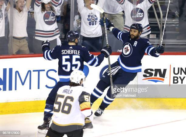 Dustin Byfuglien of the Winnipeg Jets is congratulated by his teammate Mark Scheifele after scoring a first period goal against the Vegas Golden...