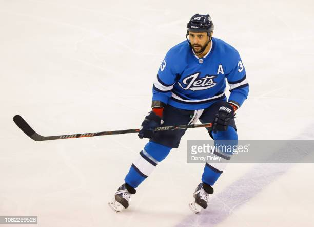 Dustin Byfuglien of the Winnipeg Jets keeps an eye on the play during second period action against the Chicago Blackhawks at the Bell MTS Place on...