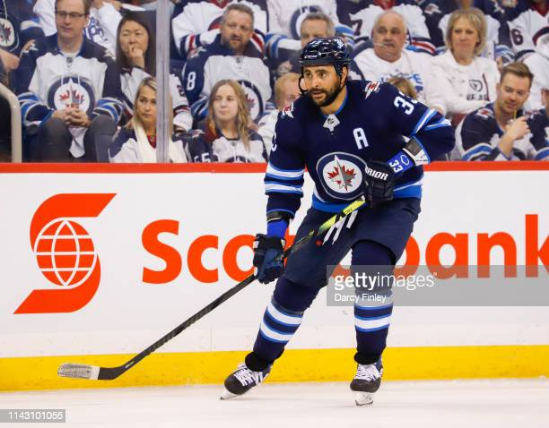 Dustin Byfuglien of the Winnipeg Jets keeps an eye on the play during second period action against the St Louis Blues in Game Two of the Western...