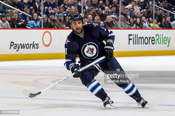 Dustin Byfuglien of the Winnipeg Jets keeps an eye on the play during second period action against the Dallas Stars at the MTS Centre on February 23...