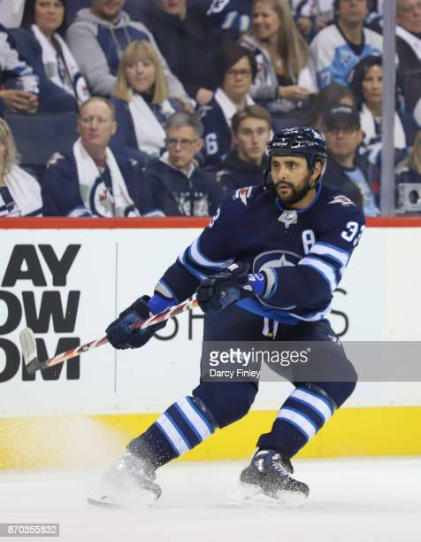 Dustin Byfuglien of the Winnipeg Jets keeps an eye on the play during second period action against the Pittsburgh Penguins at the Bell MTS Place on...