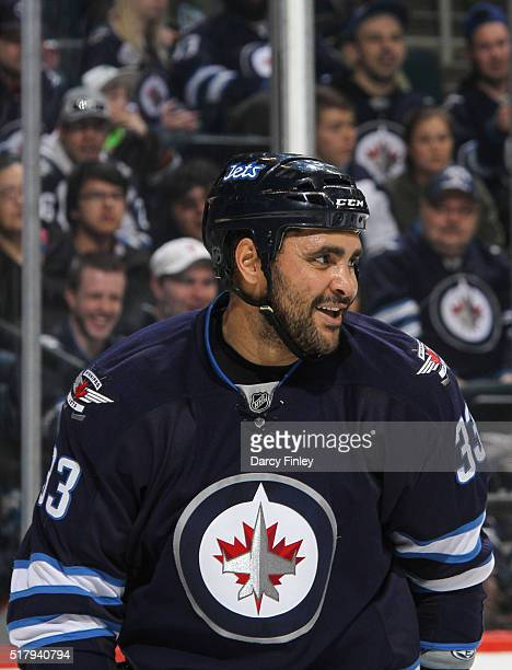 Dustin Byfuglien of the Winnipeg Jets looks on during a third period stoppage in play against the Anaheim Ducks at the MTS Centre on March 20 2016 in...