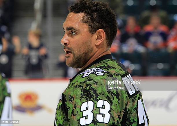 Dustin Byfuglien of the Winnipeg Jets looks on during the pregame warm up prior to NHL action against the Edmonton Oilers at the MTS Centre on March...