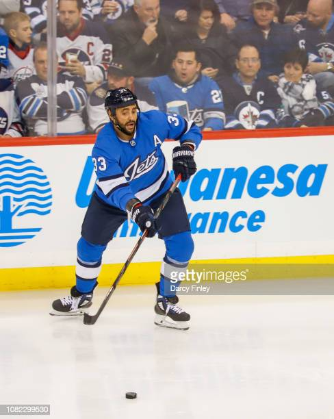 Dustin Byfuglien of the Winnipeg Jets passes the puck down the ice during second period action against the Chicago Blackhawks at the Bell MTS Place...