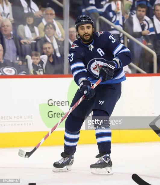 Dustin Byfuglien of the Winnipeg Jets passes the puck down the ice during second period action against the Pittsburgh Penguins at the Bell MTS Place...