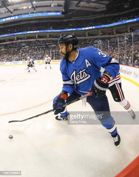 Dustin Byfuglien of the Winnipeg Jets plays the puck along the boards during first period action against the Chicago Blackhawks at the Bell MTS Place...