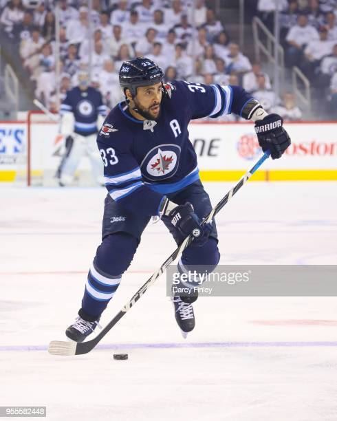 Dustin Byfuglien of the Winnipeg Jets plays the puck at the point during first period action against the Nashville Predators in Game Four of the...