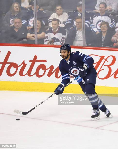 Dustin Byfuglien of the Winnipeg Jets plays the puck up the ice during first period action against the Washington Capitals at the Bell MTS Place on...