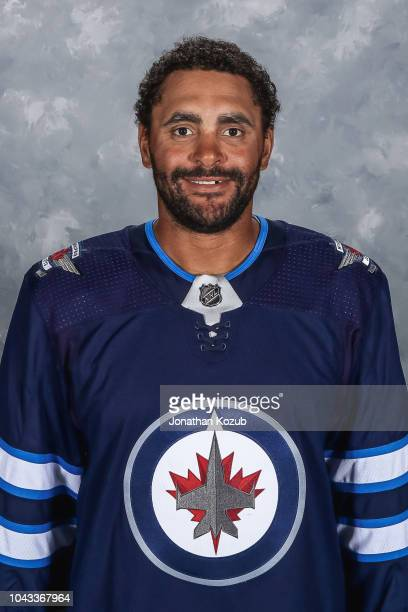 Dustin Byfuglien of the Winnipeg Jets poses for his official headshot for the 20182019 season on September 13 2018 at the Bell MTS Iceplex in...