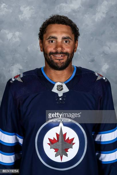 Dustin Byfuglien of the Winnipeg Jets poses for his official headshot for the 20172018 season on September 14 2017 at the Bell MTS Iceplex in...
