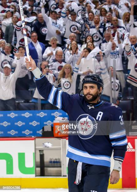 Dustin Byfuglien of the Winnipeg Jets salutes the crowd after receiving third star honours following a 50 shutout victory over the Minnesota Wild in...