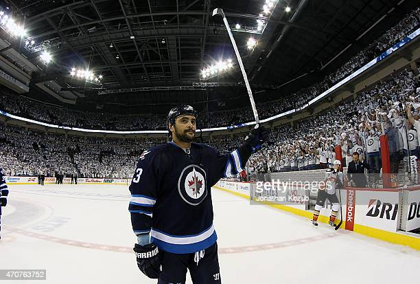 Dustin Byfuglien of the Winnipeg Jets salutes the home fans after a season ending 52 loss to the Anaheim Ducks in Game Four of the Western Conference...