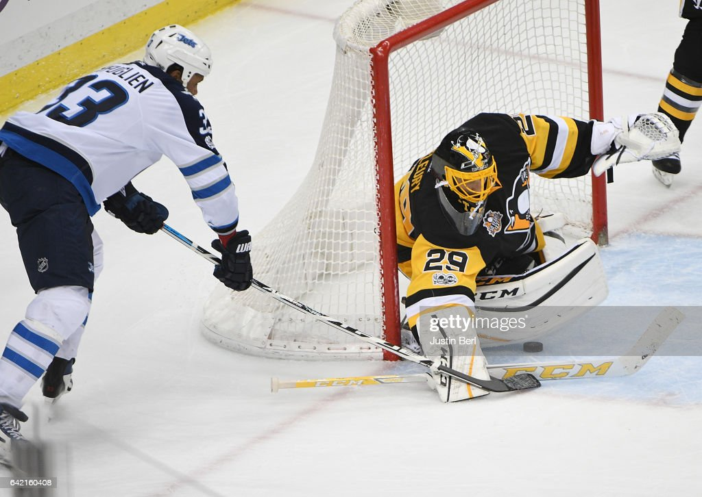 Dustin Byfuglien #33 of the Winnipeg Jets scores a goal past Marc-Andre Fleury #29 of the Pittsburgh Penguins in the third period during the game at PPG PAINTS Arena on February 16, 2017 in Pittsburgh, Pennsylvania.