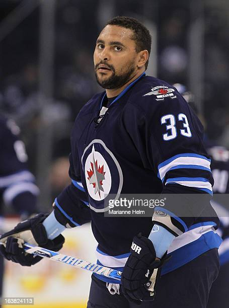 Dustin Byfuglien of the Winnipeg Jets skates on the ice during the pregame warmup before a game against the Toronto Maple Leafs on March 12 2013 at...