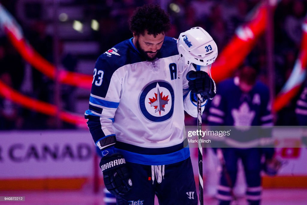 Dustin Byfuglien #33 of the Winnipeg Jets stands for the national anthem before facing the Toronto Maple Leafs at the Air Canada Centre on March 31, 2018 in Toronto, Ontario, Canada.
