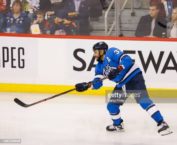 Dustin Byfuglien of the Winnipeg Jets takes a shot on net during second period action against the Chicago Blackhawks at the Bell MTS Place on...
