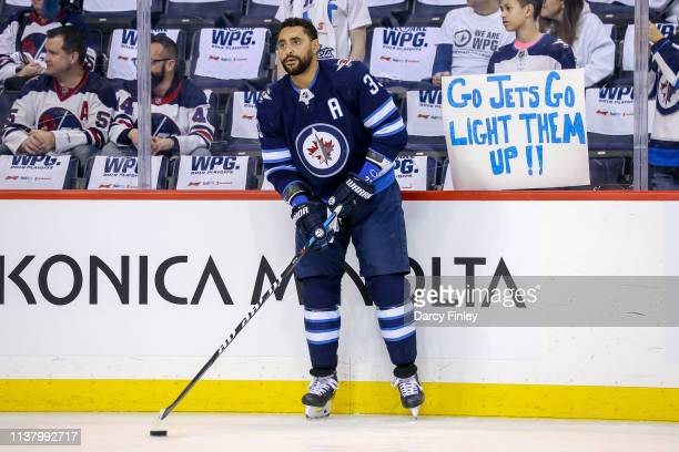 Dustin Byfuglien of the Winnipeg Jets takes part in the pregame warm up prior to NHL action against the St Louis Blues in Game Five of the Western...