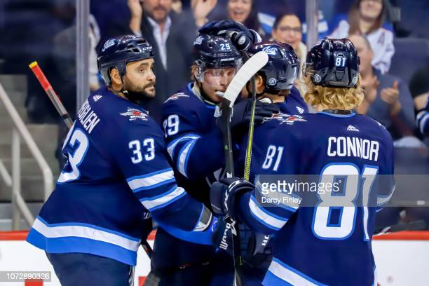 Dustin Byfuglien Patrik Laine Ben Chiarot and Kyle Connor of the Winnipeg Jets celebrate a second period goal against the Edmonton Oilers at the Bell...