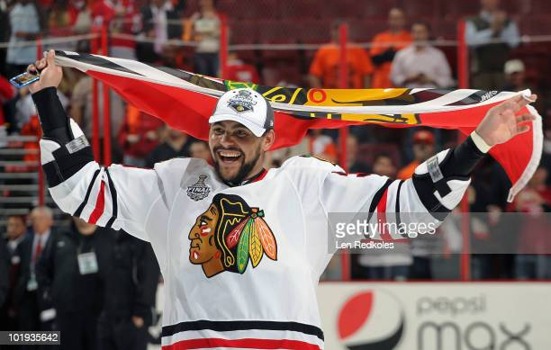 Dustin Byfuglien the Chicago Blackhawks skates with a Blackhawks flag after defeating the Philadelphia Flyers 43 to win the Stanley Cup in Game Six...
