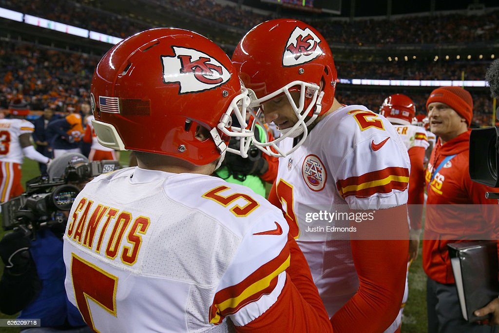 Dustin Colquitt #2 of the Kansas City Chiefs celebrates with kicker Cairo Santos #5 after he made a game-winning field goal in overtime against the Denver Broncos at Sports Authority Field at Mile High on November 27, 2016 in Denver, Colorado.