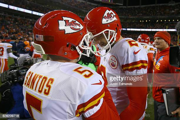 Dustin Colquitt of the Kansas City Chiefs celebrates with kicker Cairo Santos after he made a gamewinning field goal in overtime against the Denver...