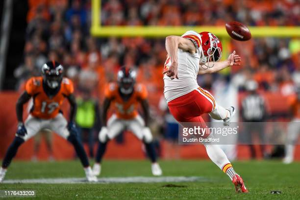 Dustin Colquitt of the Kansas City Chiefs kicks off against the Denver Broncos in the second quarter at Empower Field at Mile High on October 17 2019...