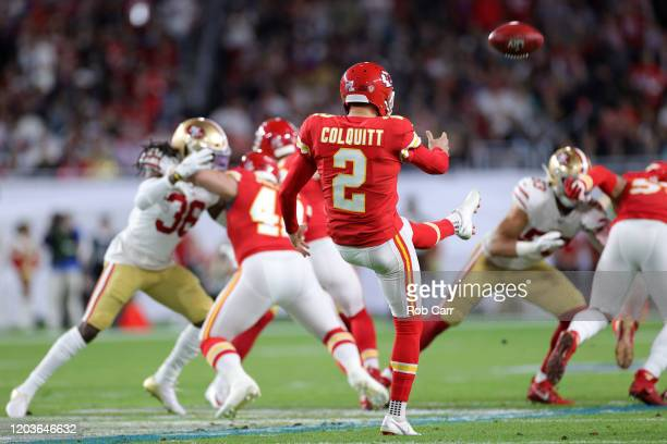 Dustin Colquitt of the Kansas City Chiefs kicks the ball against the San Francisco 49ers during the first half in Super Bowl LIV at Hard Rock Stadium...