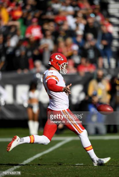 Dustin Colquitt of the Kansas City Chiefs punts the ball against the Oakland Raiders during the first half of an NFL football game at OaklandAlameda...