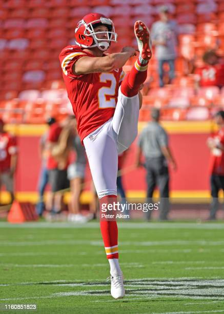 Dustin Colquitt of the Kansas City Chiefs punts the ball during pregame warm ups before a preseason game against the Cincinnati Bengals at Arrowhead...