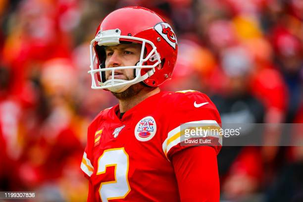 Dustin Colquitt of the Kansas City Chiefs walks back to the bench following a blocked punt returned for a touchdown during the first quarter of the...