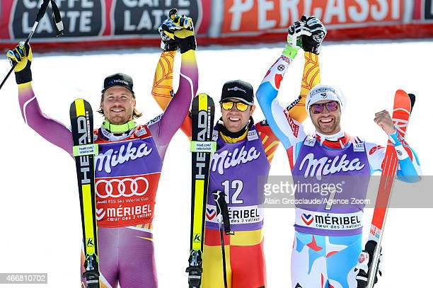 Dustin Cook of Canada takes 1st place Kjetil Jansrud of Norway takes 2nd place and wins the overall SuperG World Cup globe Brice Roger of France...