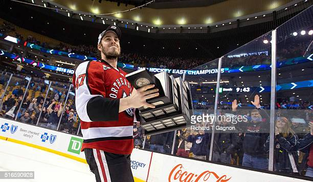 Dustin Darou of the Northeastern Huskies celebrates after the Huskies won the Hockey East Championship Final against the Massachusetts Lowell River...