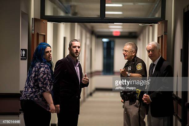 Dustin Diamond and fiancee Amanda Schutz leftwalk in the Ozaukee County Courthouse for their trial on May 28 2015 in Port Washington Wisconsin...